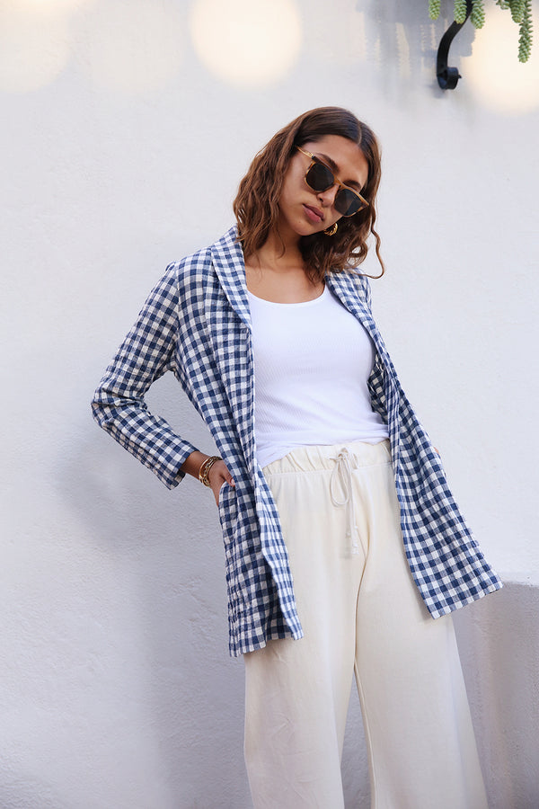 Model wearing the lady & the sailor Painter's Jacket in Bleu Gingham.
