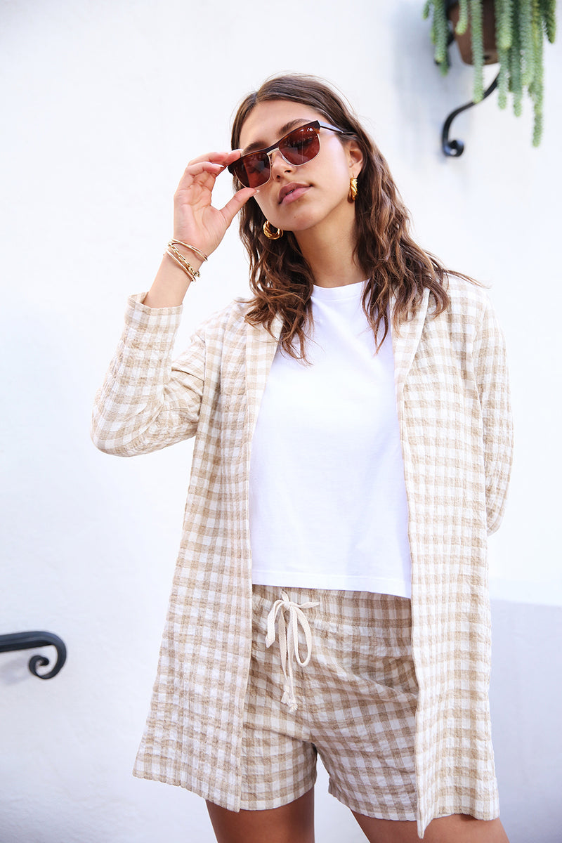 Model wearing the lady & the sailor Painter's Jacket in Wheat Gingham.