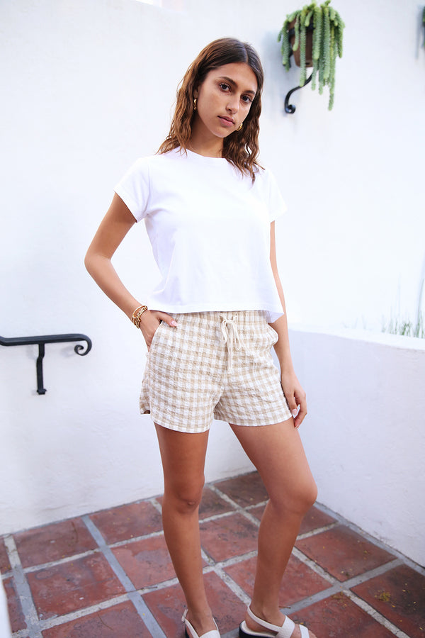 Model wearing the lady & the sailor Weekend Shorts in Wheat Gingham.