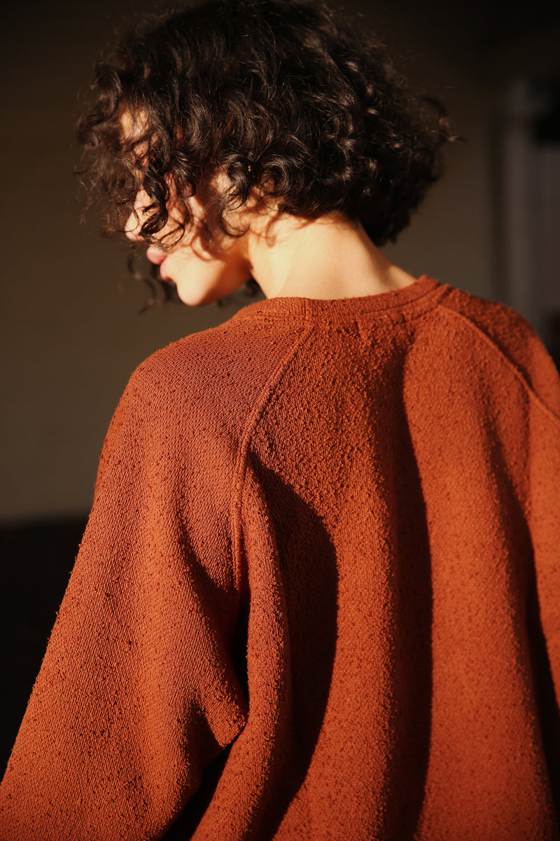 Model wearing the lady & the sailor Brentwood Sweatshirt in Copper Boucle.