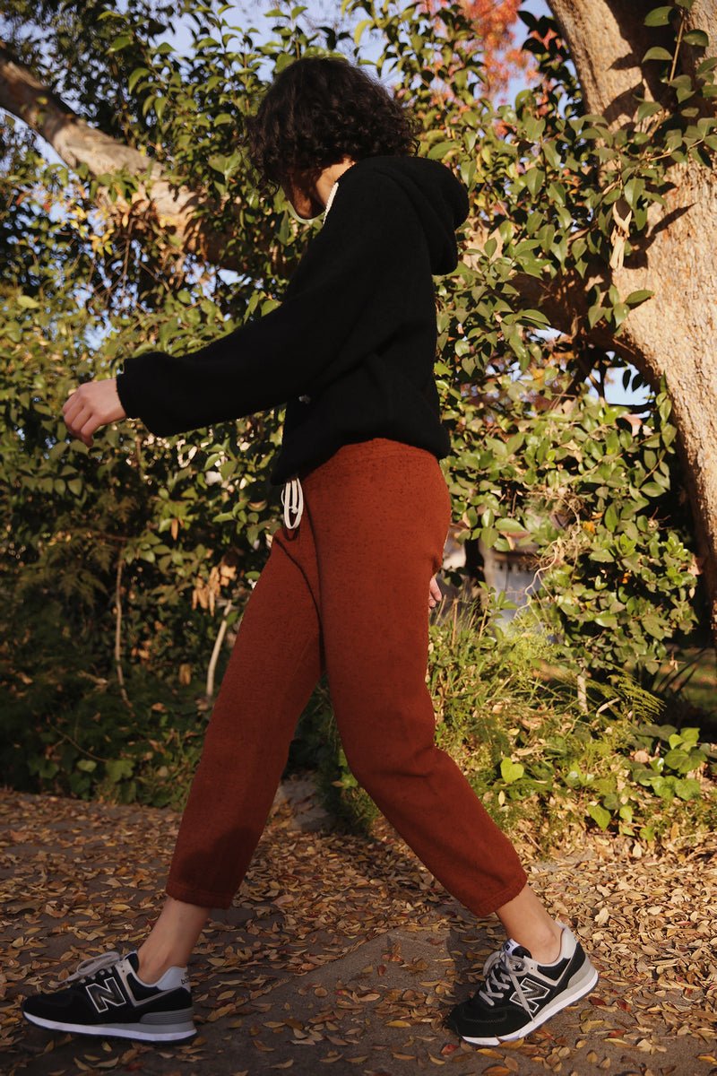 Model wearing the lady & the sailor Vintage Sweatpant in Copper Boucle.