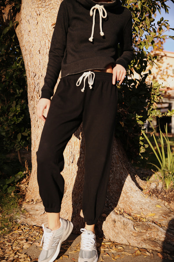 Model wearing the lady & the sailor Vintage Sweatpant in Black Organic Cotton.