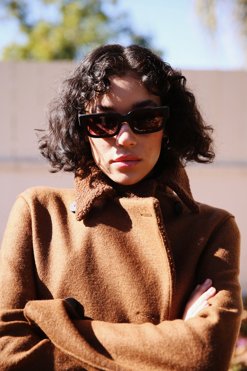 Model wearing Harris Wharf Military Coat in Caramel.