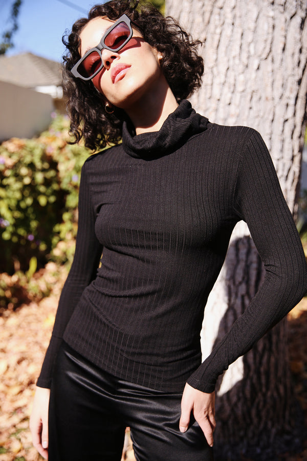 Model wearing the lady & the sailor Classic Turtleneck in Black Pointelle.