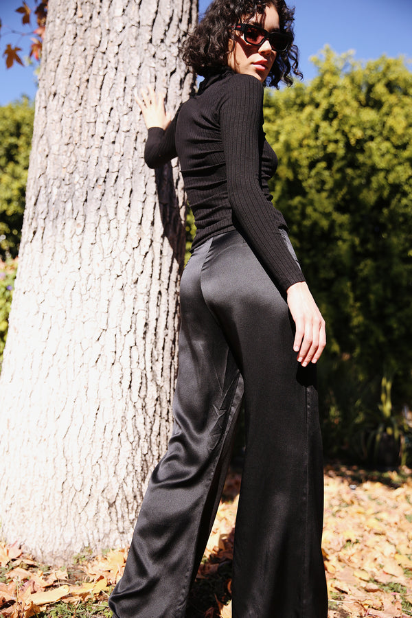 Model wearing the lady & the sailor Relaxed Silk Pant in Black.