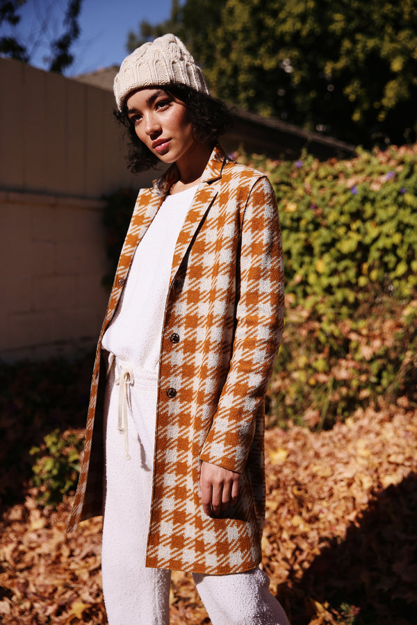 Model wearing Harris Wharf Cocoon Coat in Marigold Gingham.