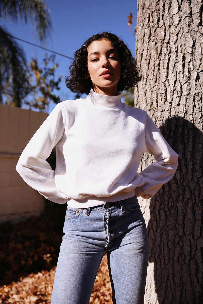 Model wearing the lady & the sailor Balloon Sleeve Mockneck in Vanilla Fleece.