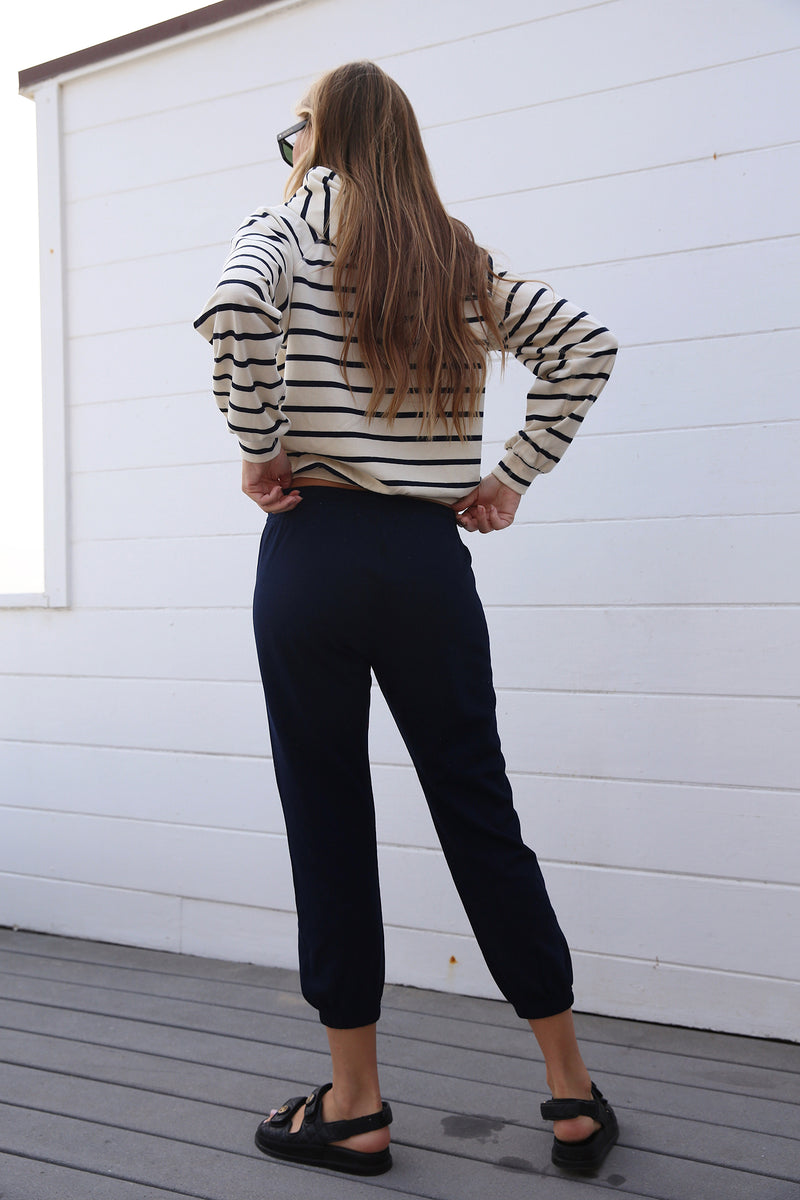 Model wearing the lady & the sailor Vintage Sweatpant in Navy Mineral Terry.