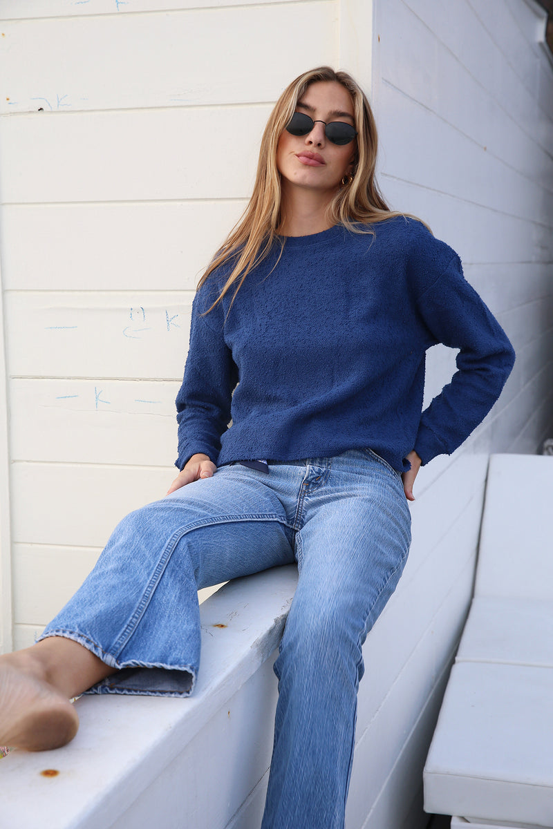 Model wearing the lady & the sailor Vintage Sweatshirt in Royal Boucle.