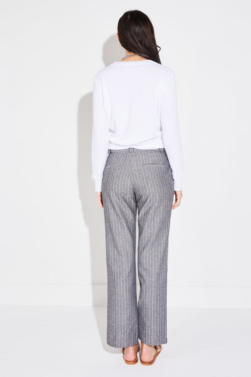 Model wearing the lady & the sailor Ankle Trouser in Tomboy Stripe, back view.