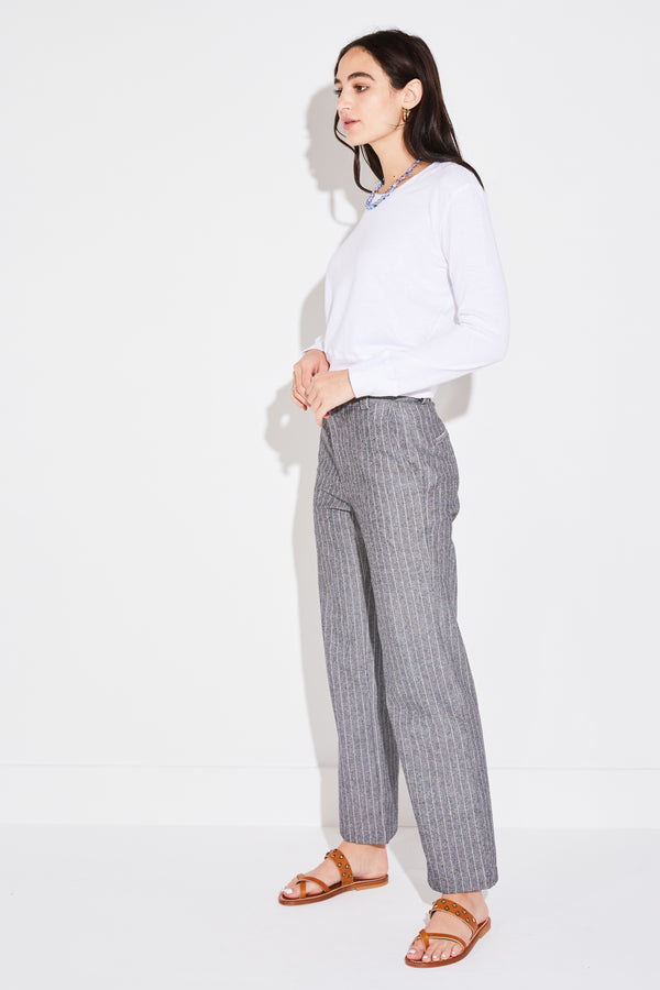 Model wearing the lady & the sailor Ankle Trouser in Tomboy Stripe, side view.