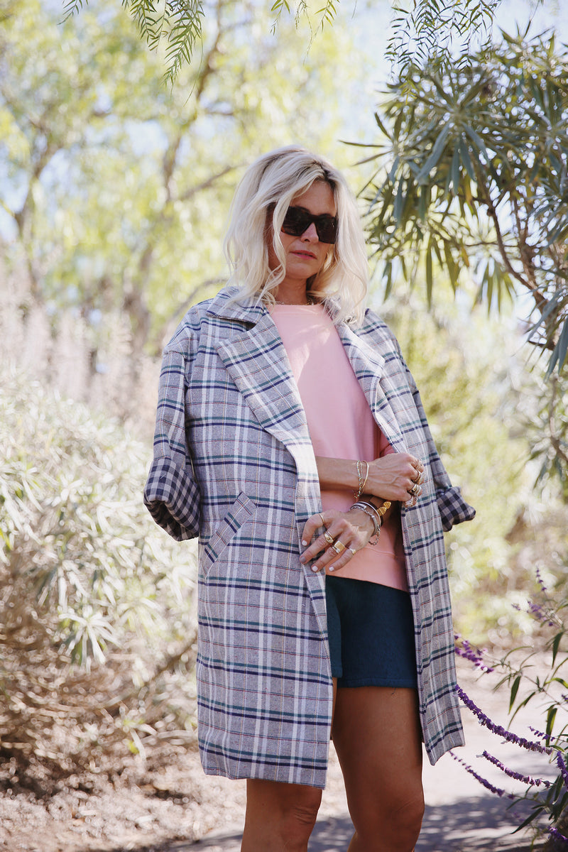 Model wearing the lady & the sailor Relaxed Collared Coat in Ivory Plaid with Taupe Gingham.