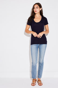 Model wearing the lady & the sailor Basic Tee in navy tencel.