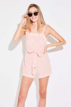 Model wearing the lady & the sailor The Beach Playsuit in pale pink gauze.