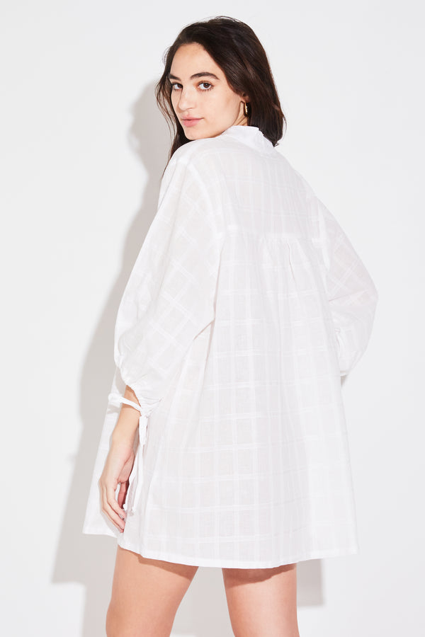 Model wearing the lady & the sailor Billow Sleeve Tunic Dress in white windowpane cotton.