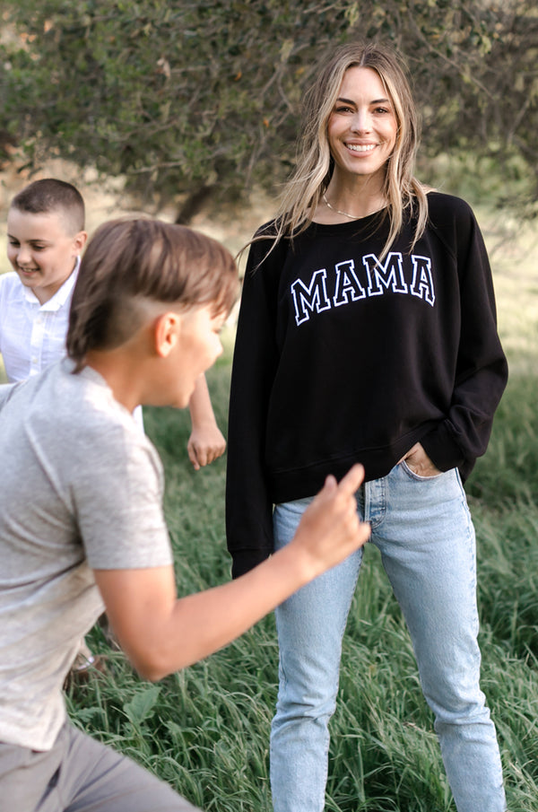 Model wearing the lady & the sailor Brentwood Sweatshirt in Black with White Embroidery.