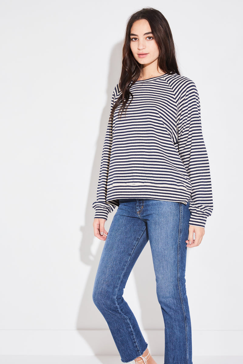 Model wearing the lady & the sailor Brentwood Sweatshirt in navy vintage stripe cotton.