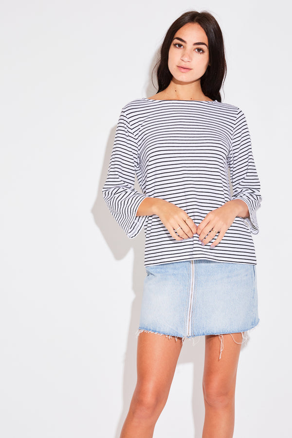 Model wearing the lady & the sailor Breton Tee in white stripe.