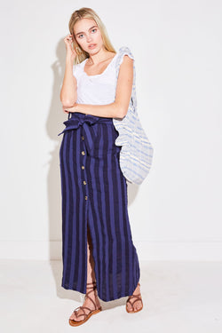 Model wearing the lady & the sailor Ruffle Bag in blue jacquard stripe.