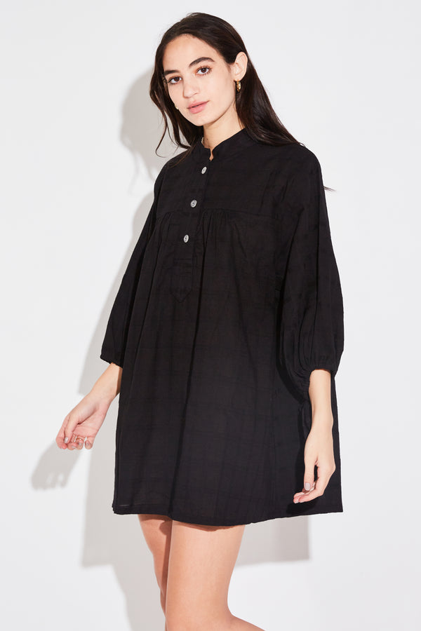 Model wearing the lady & the sailor Billow Sleeve Tunic Dress in black windowpane