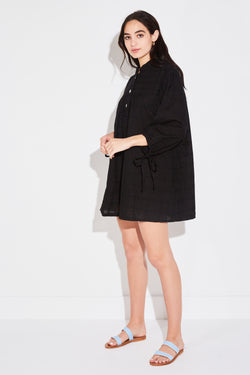 Model wearing the lady & the sailor Billow Sleeve Tunic Dress in black windowpane side angle