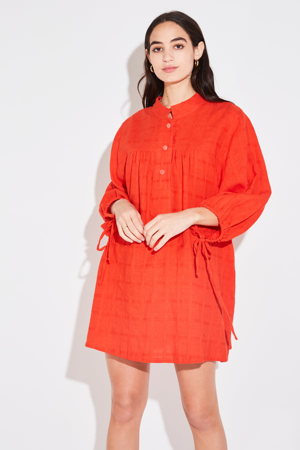 Model wearing the lady & the sailor Billow Sleeve Tunic Dress in orange poppy windowpane.