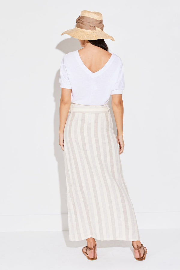 Model wearing the lady & the sailor Button Front Skirt in natural linen stripe.