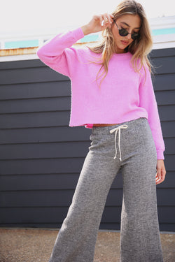 Model wearing the lady & the sailor Vintage Sweatshirt in Bubblegum Boucle.
