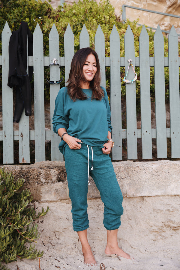 Model wearing the lady & the sailor Vintage Sweatpant in Emerald Bay Green Boucle.