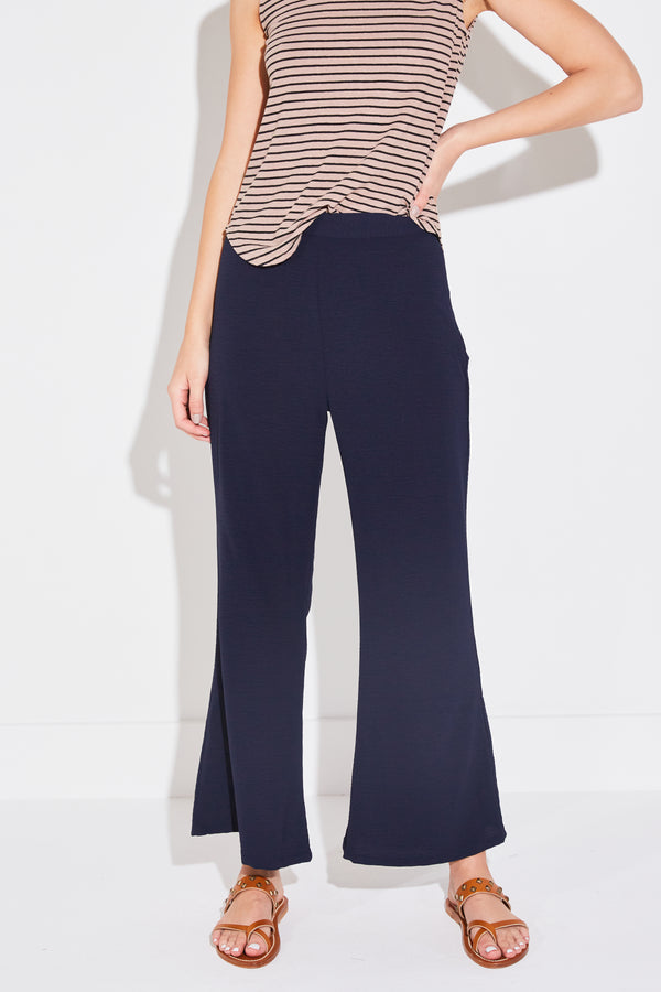 Model wearing the lady & the sailor Cropped Relaxed Pant in Navy Airflow