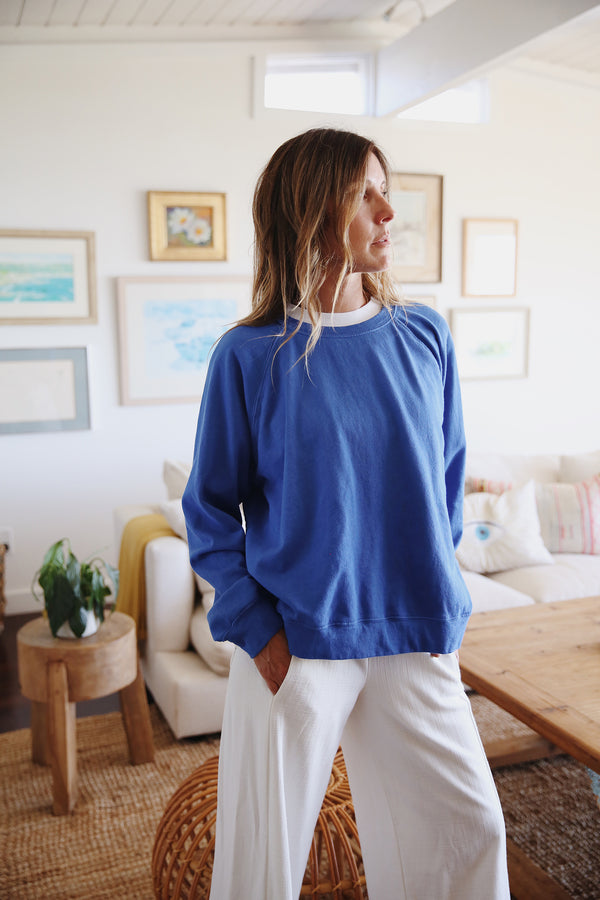 Model wearing the lady & the sailor Brentwood Sweatshirt in Laguna Blue Organic Cotton.