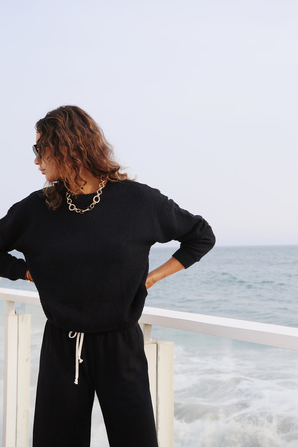 Model wearing the lady & the sailor Vintage Sweatshirt in Black Boucle.