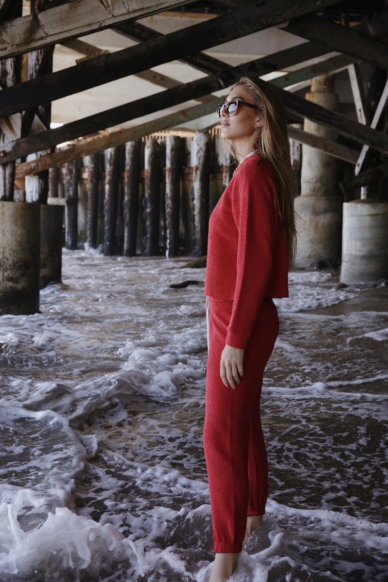 Model wearing the lady & the sailor Vintage Sweatpant in Poppy Boucle.