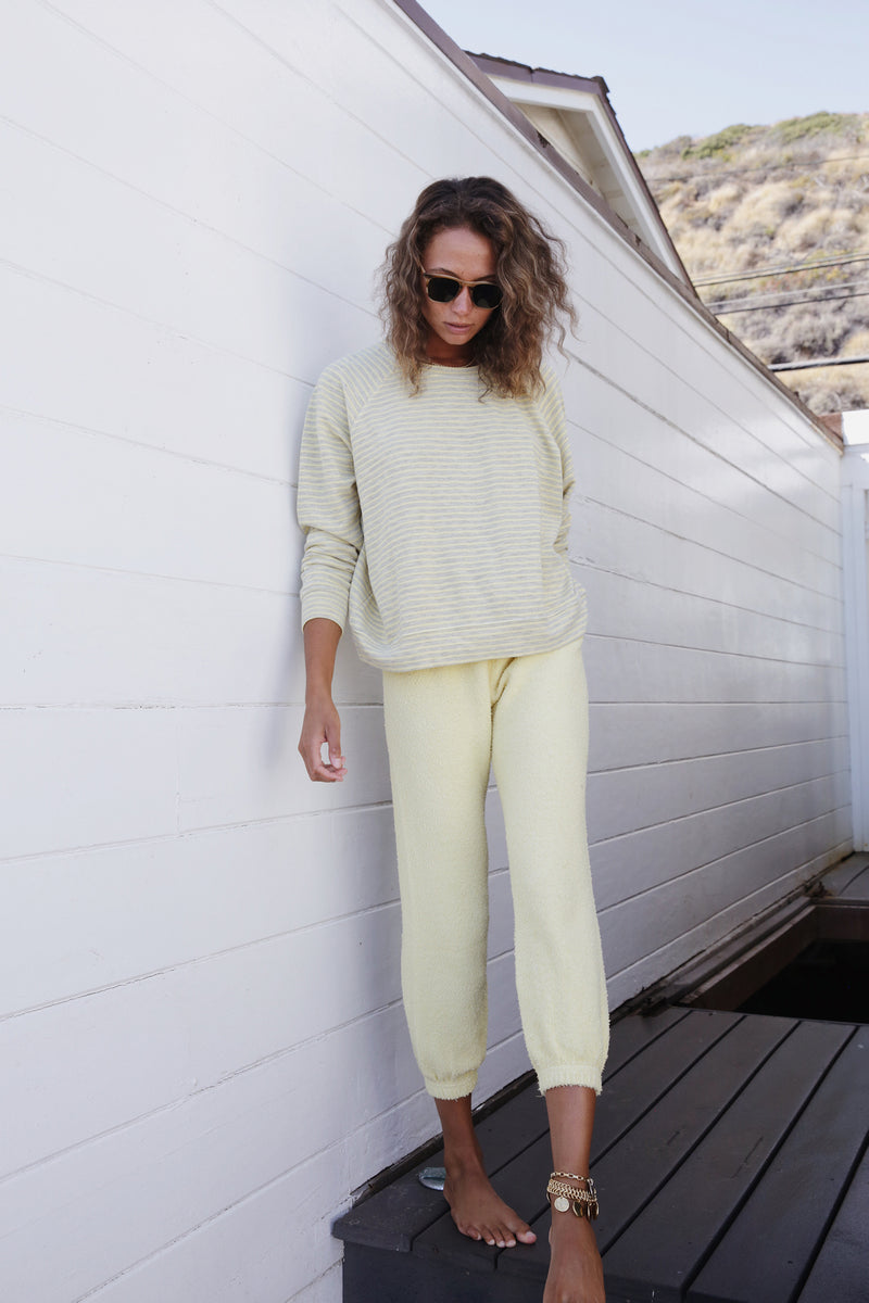 Model wearing the lady & the sailor Vintage Sweatpant in Citrus Yellow Boucle.