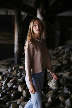 Model wearing the lady & the sailor Vintage Sweatshirt in Sand Boucle.
