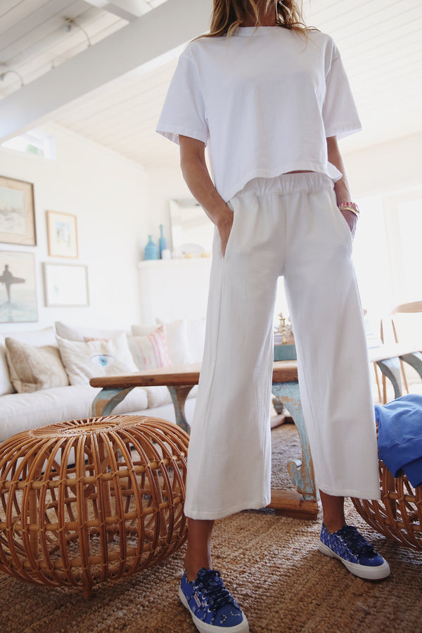 Model wearing the lady & the sailor Palazzo Pants in Natural Basketwoven.