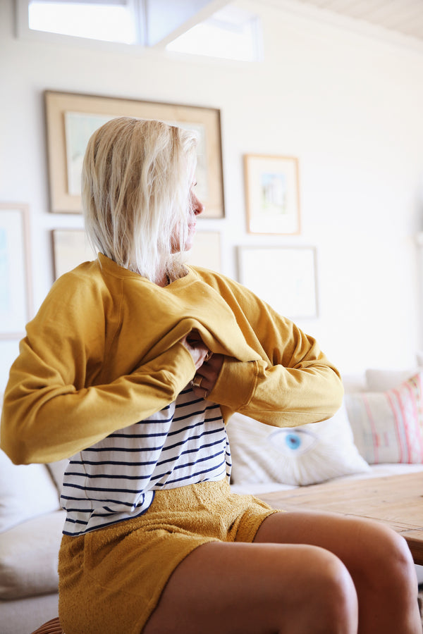 Model wearing the lady & the sailor Brentwood Sweatshirt in Golden Hour Organic Cotton.