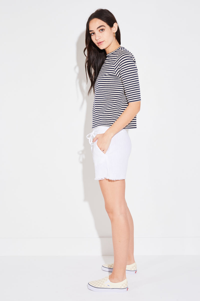 Model wearing the lady & the sailor Elbow Tee in navy vintage stripe.