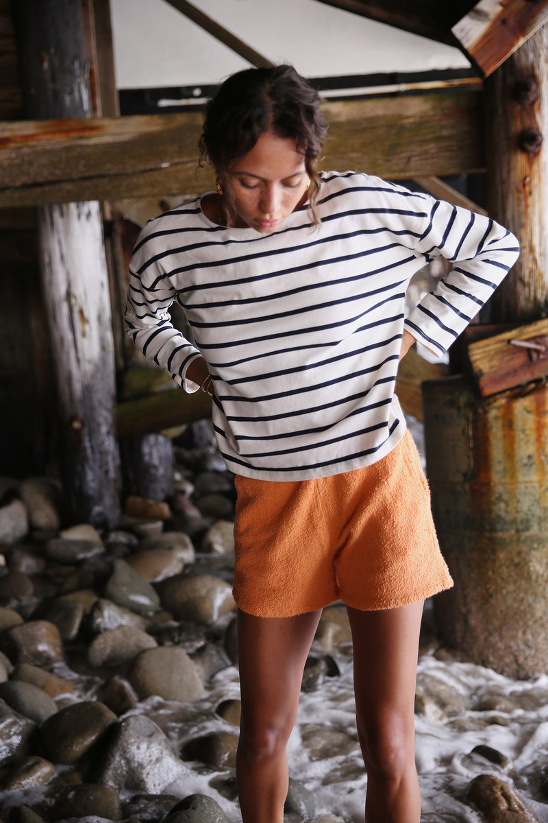 Model wearing the lady & the sailor Boxy Pullover in Nautical Stripe.