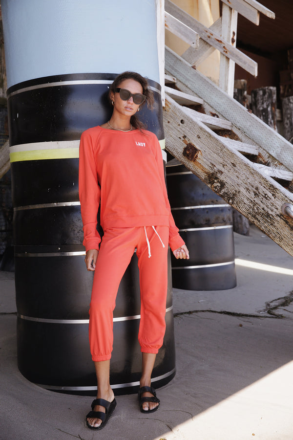 Model wearing the lady & the sailor Vintage Sweatpant in Vermillion Orange Mineral Terry.