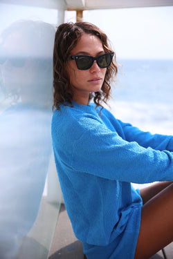 Model wearing the lady & the sailor Vintage Sweatshirt in Surf Boucle.