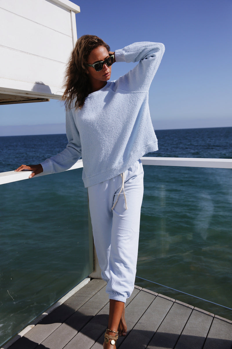 Model wearing the lady & the sailor Vintage Sweatpant in Baby Blue Mineral Terry.