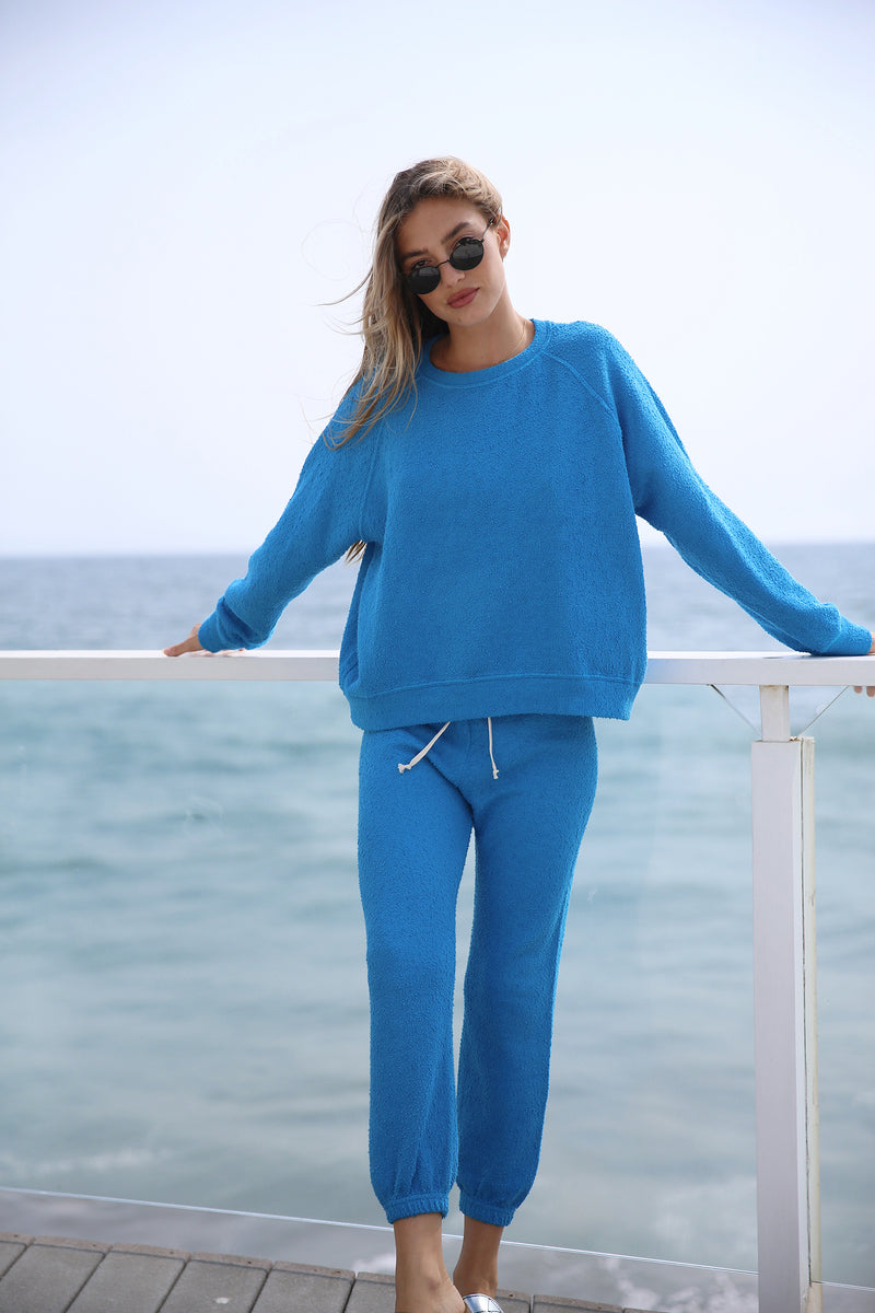 Model wearing the lady & the sailor Vintage Sweatpant in Surf Boucle.