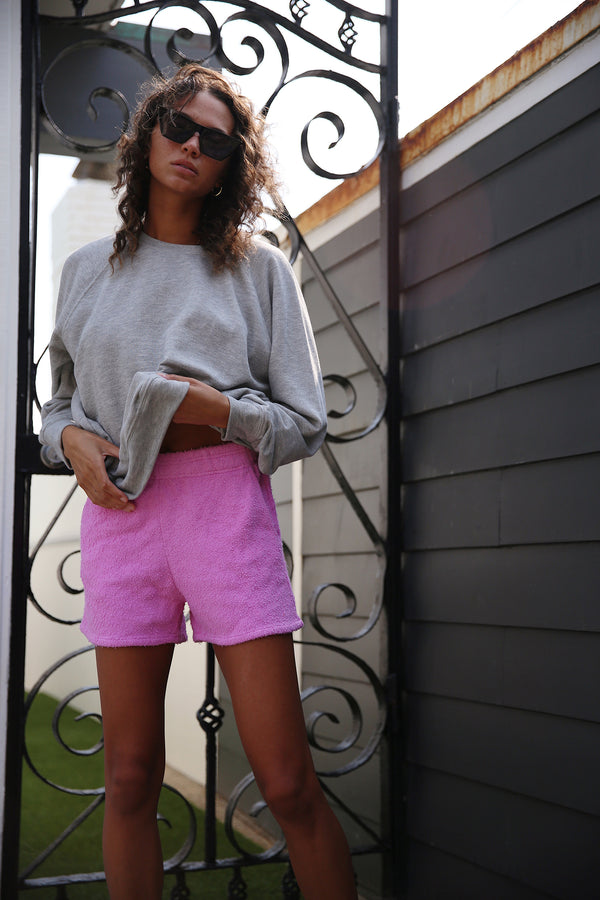 Model wearing the lady & the sailor Weekend Shorts in Bubblegum Boucle.