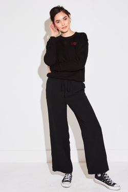 Model wearing the lady & the sailor High Waisted Pant in black air flow.
