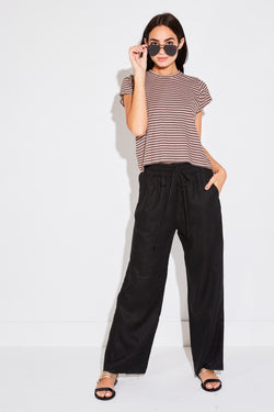 Model wearing the lady & the sailor high waisted pant in black linen.
