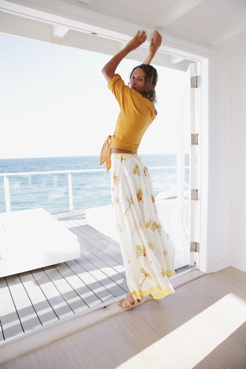 Model wearing Antik Batik Palmy Flowing Maxi Skirt in Yellow.