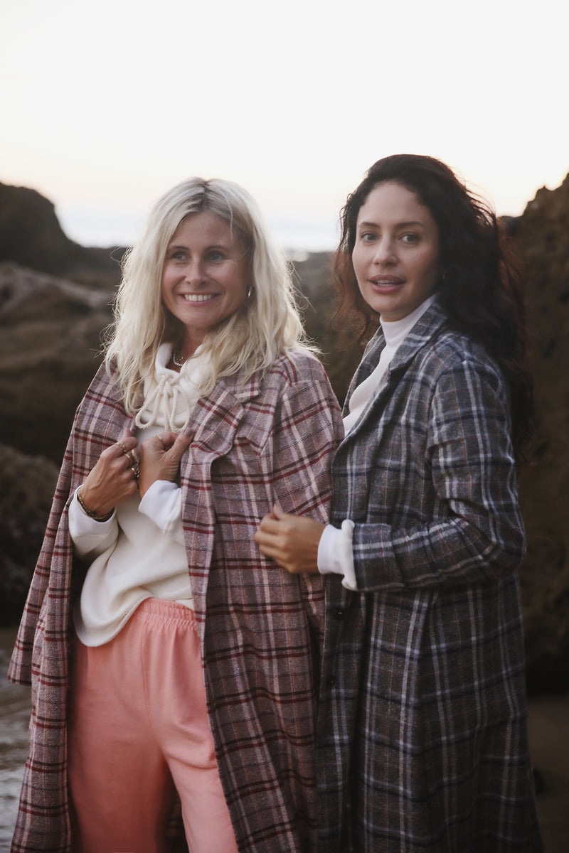 Model wearing the lady & the sailor Midi Blazer in Rust Plaid.