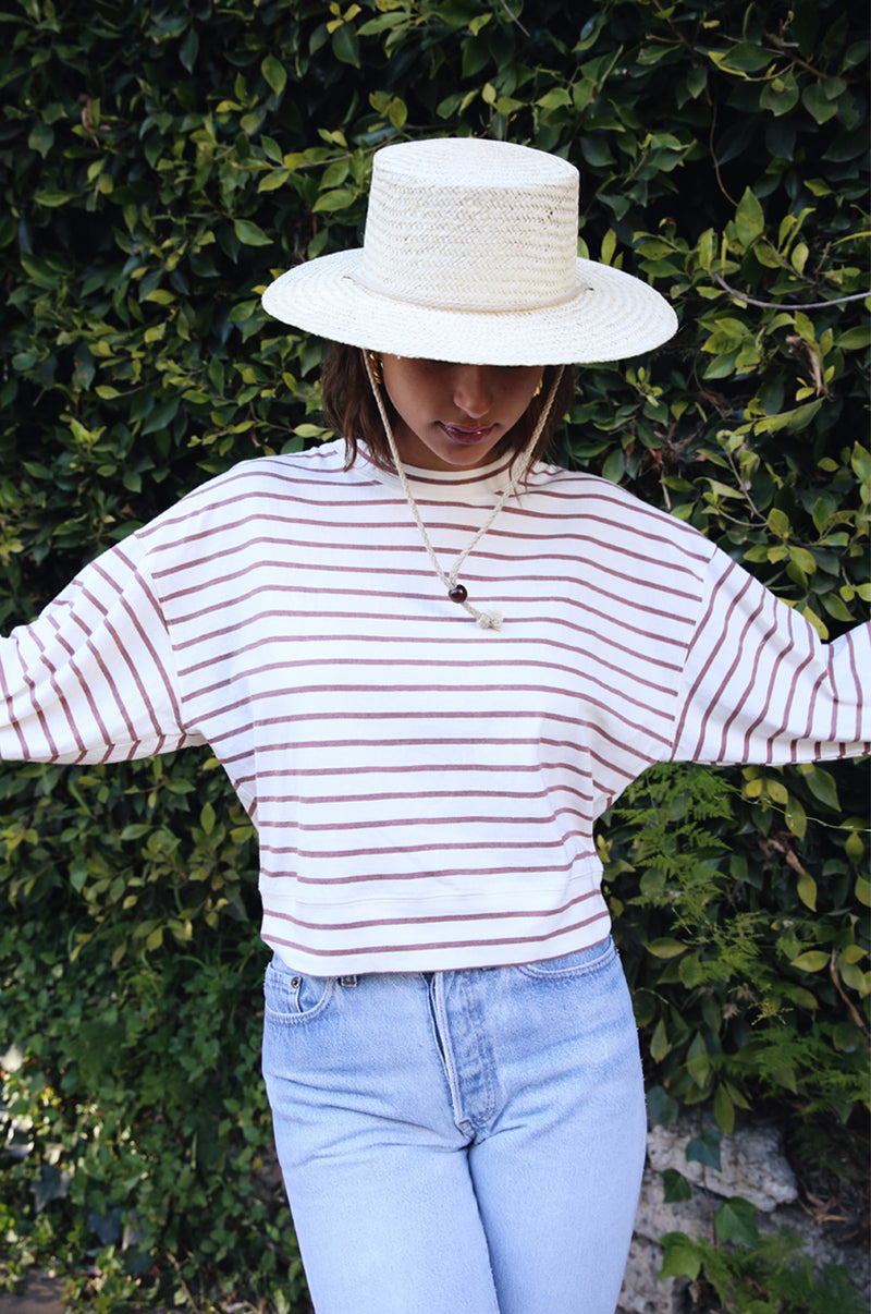 Model wearing the lady & the sailor Cropped Sweatshirt in Rose Stripe.