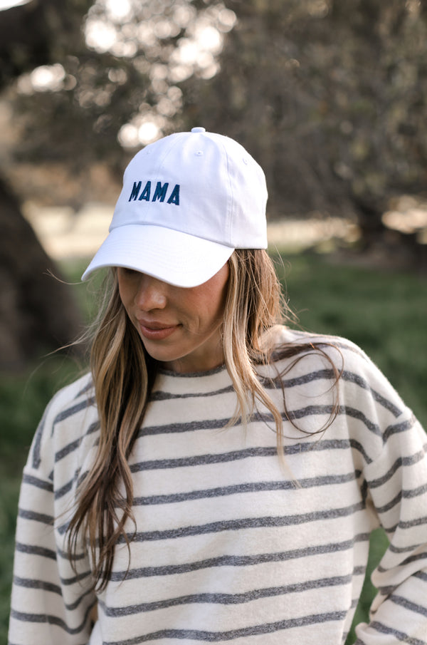 Model wearing the lady & the sailor Mama Baseball Cap in White and Navy embroidery.
